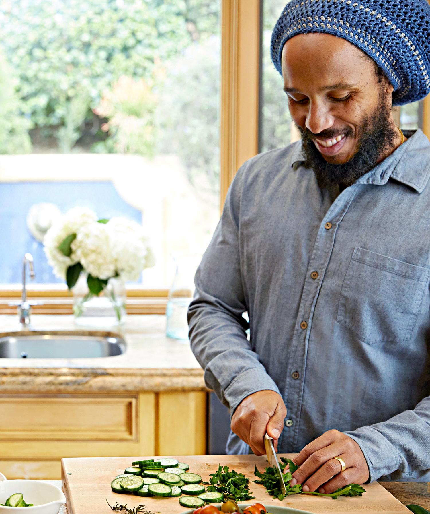 ziggy marley in kitchen preparing food