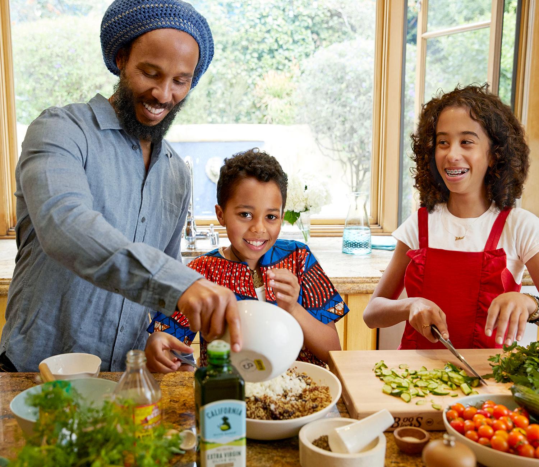 ziggy marley with children preparing quinoa