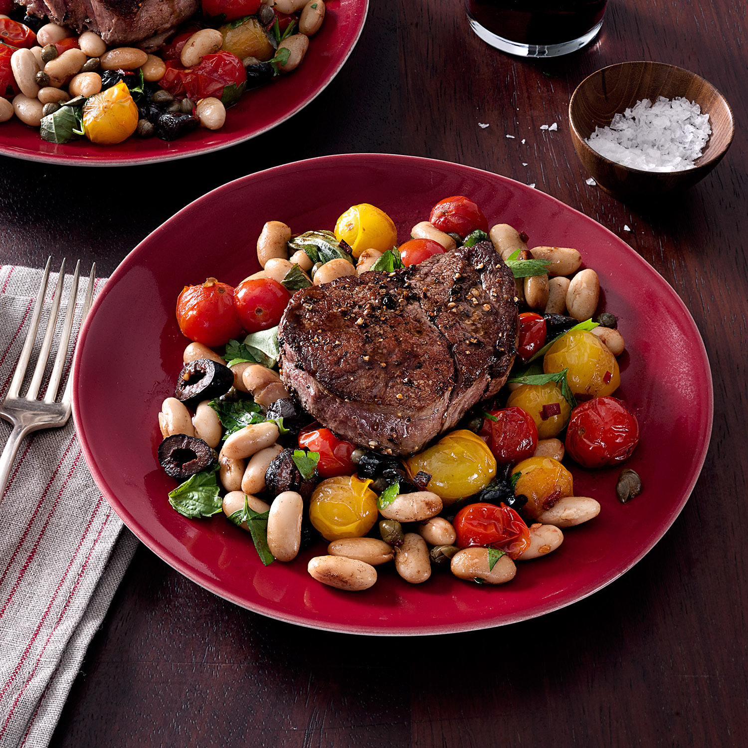 Beef Fillet with Puttanesca-Style Burst Tomatoes & White Beans