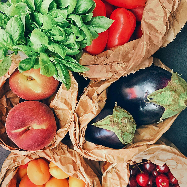 fresh veggies in paper bags