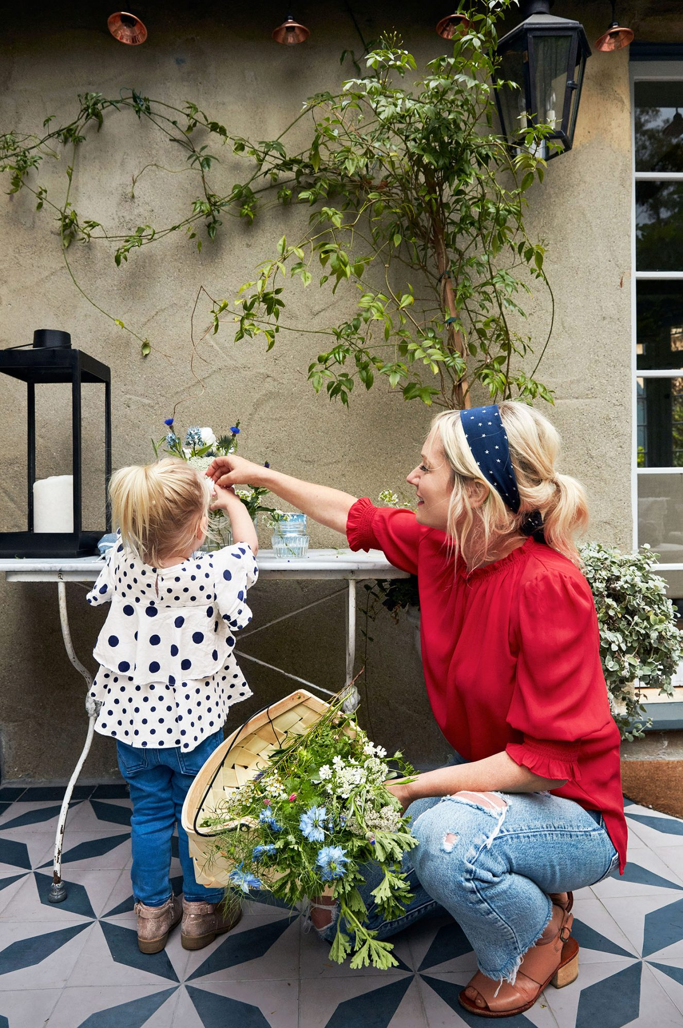 emily henderson and daughter on patio with flowers