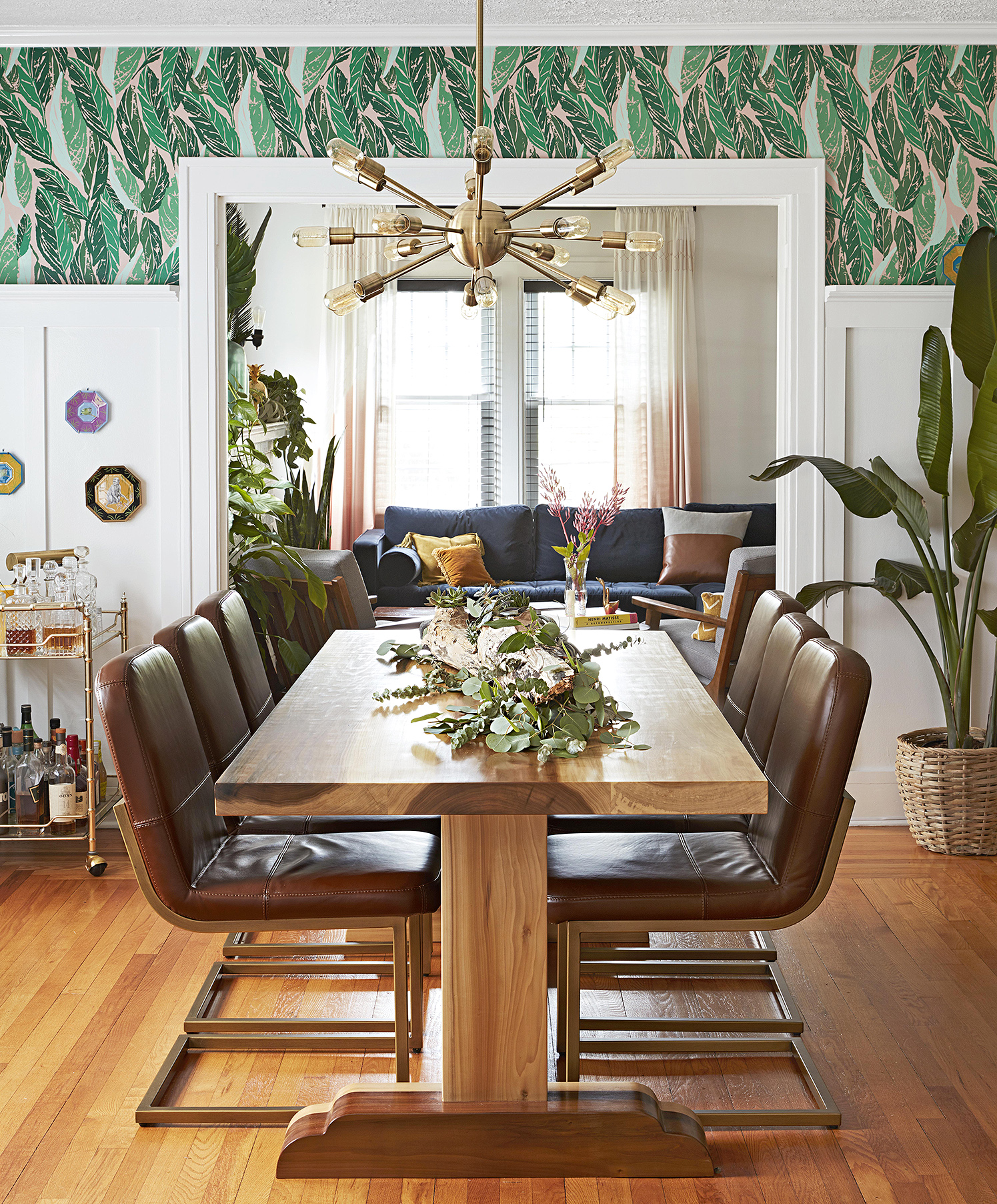 midcentury dining room with bold green wallpaper