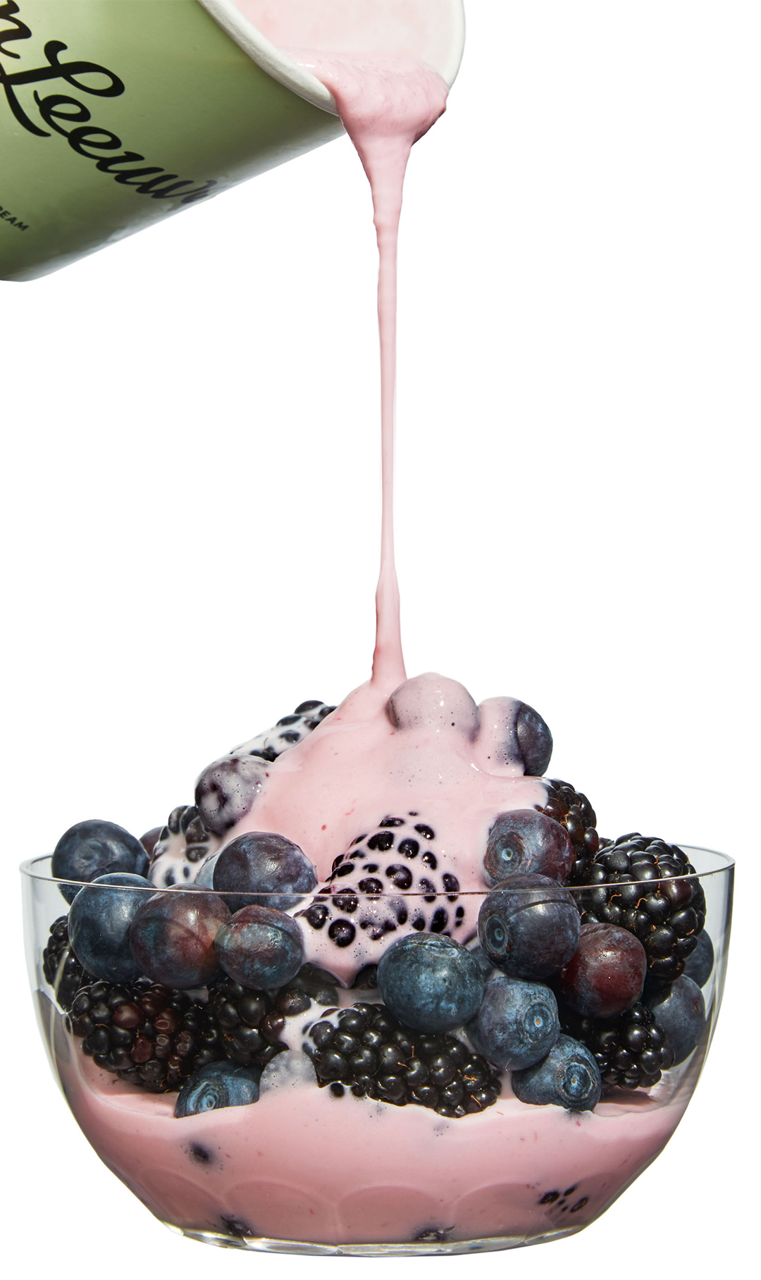 melting ice cream poured over blueberries