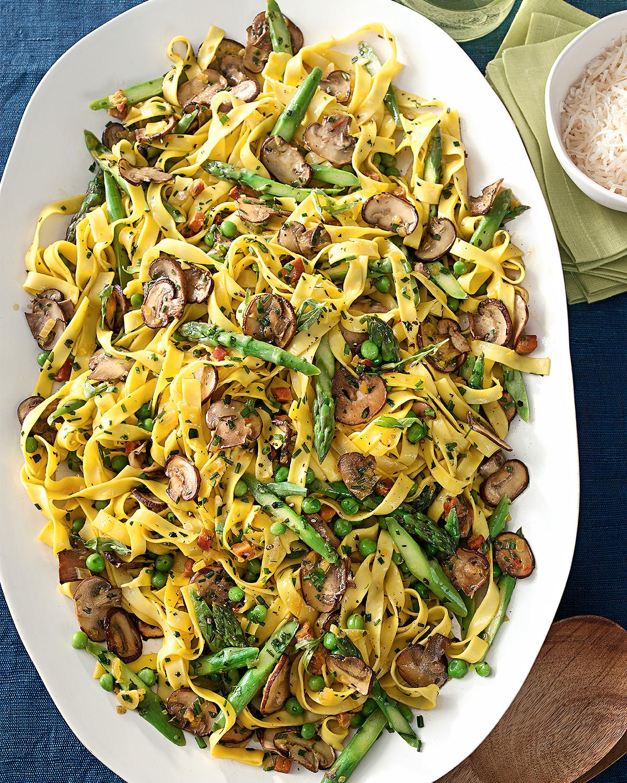 milanese style tagliatelle mushrooms asparagus peas