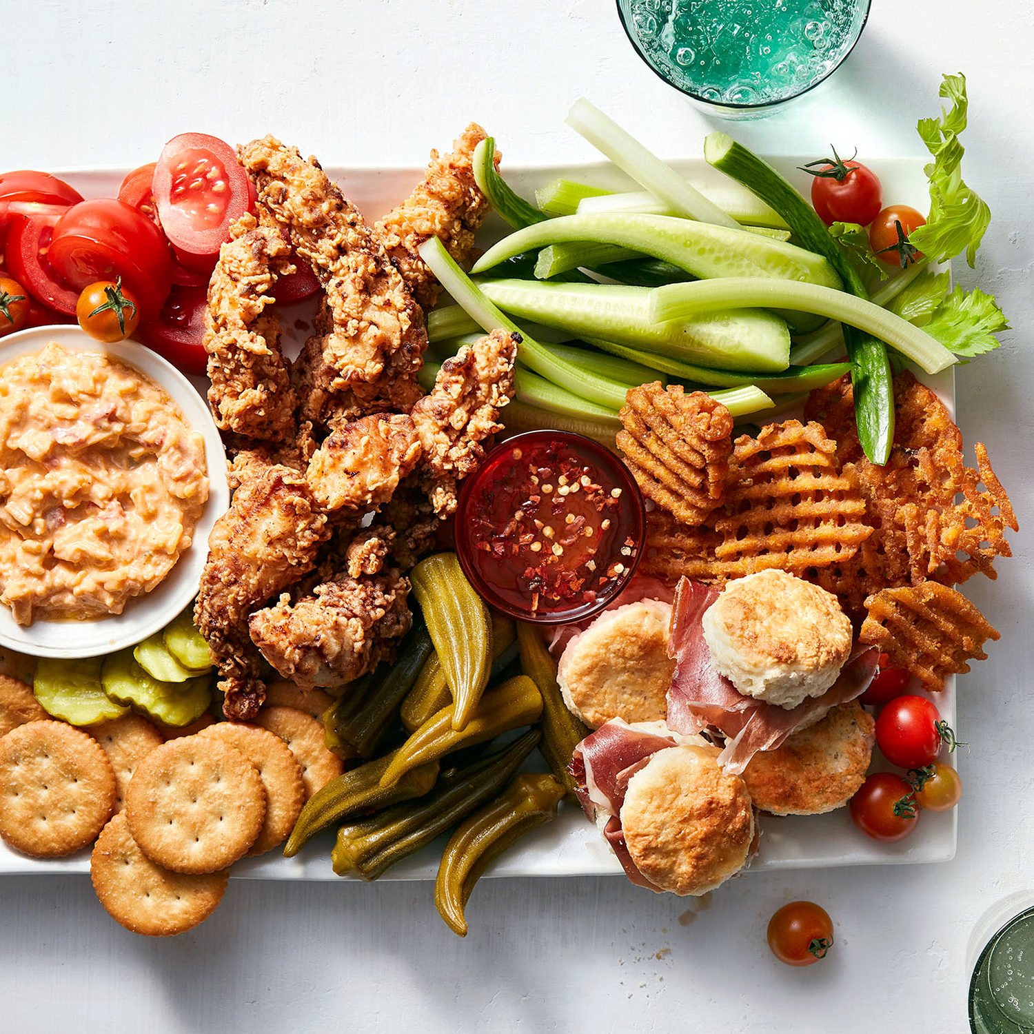 chicken and fixins platter with dip and sauce
