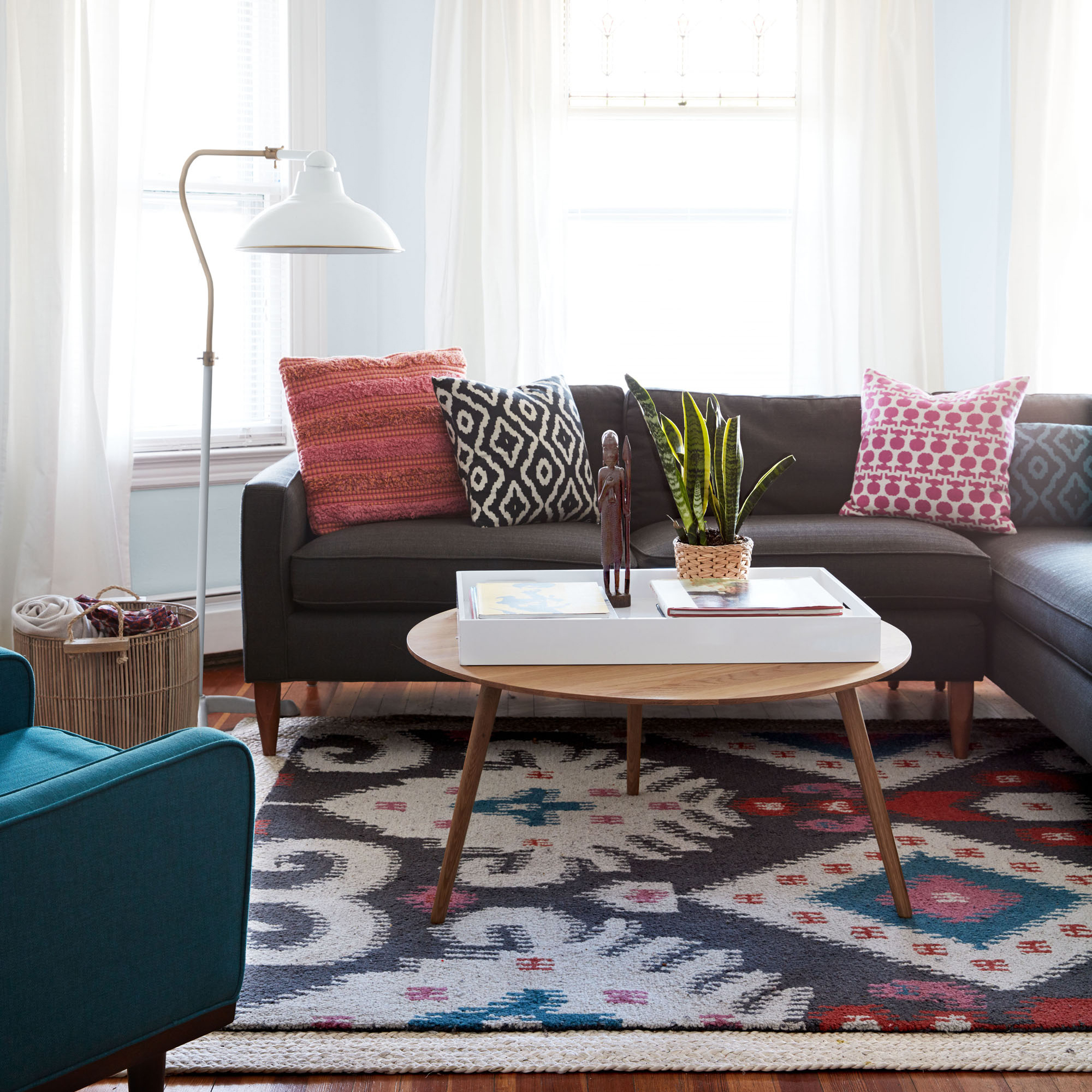 Living Room with Grey Couch and Teal Chair