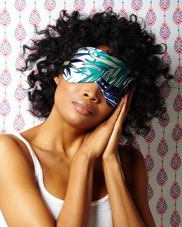 woman asleep wearing sleep eye mask