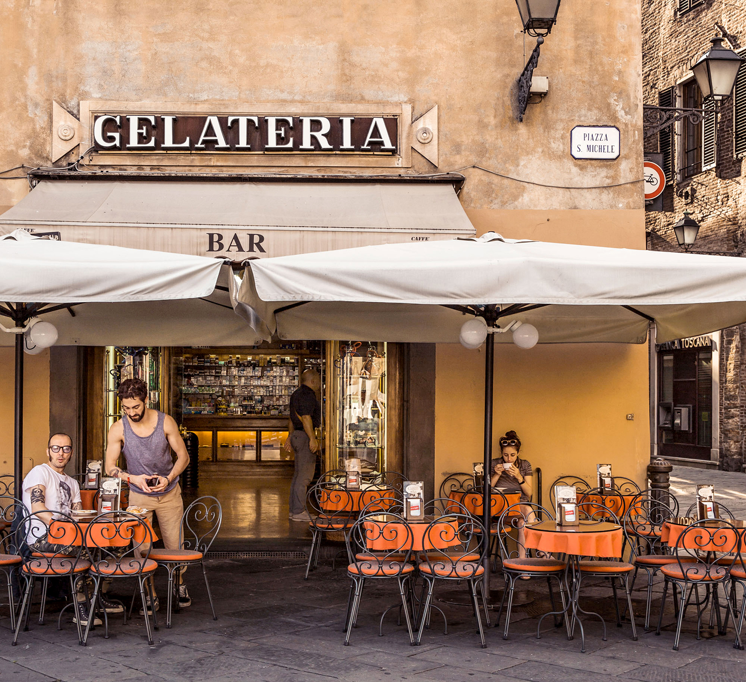 italian gelateria storefront with outdoor seating