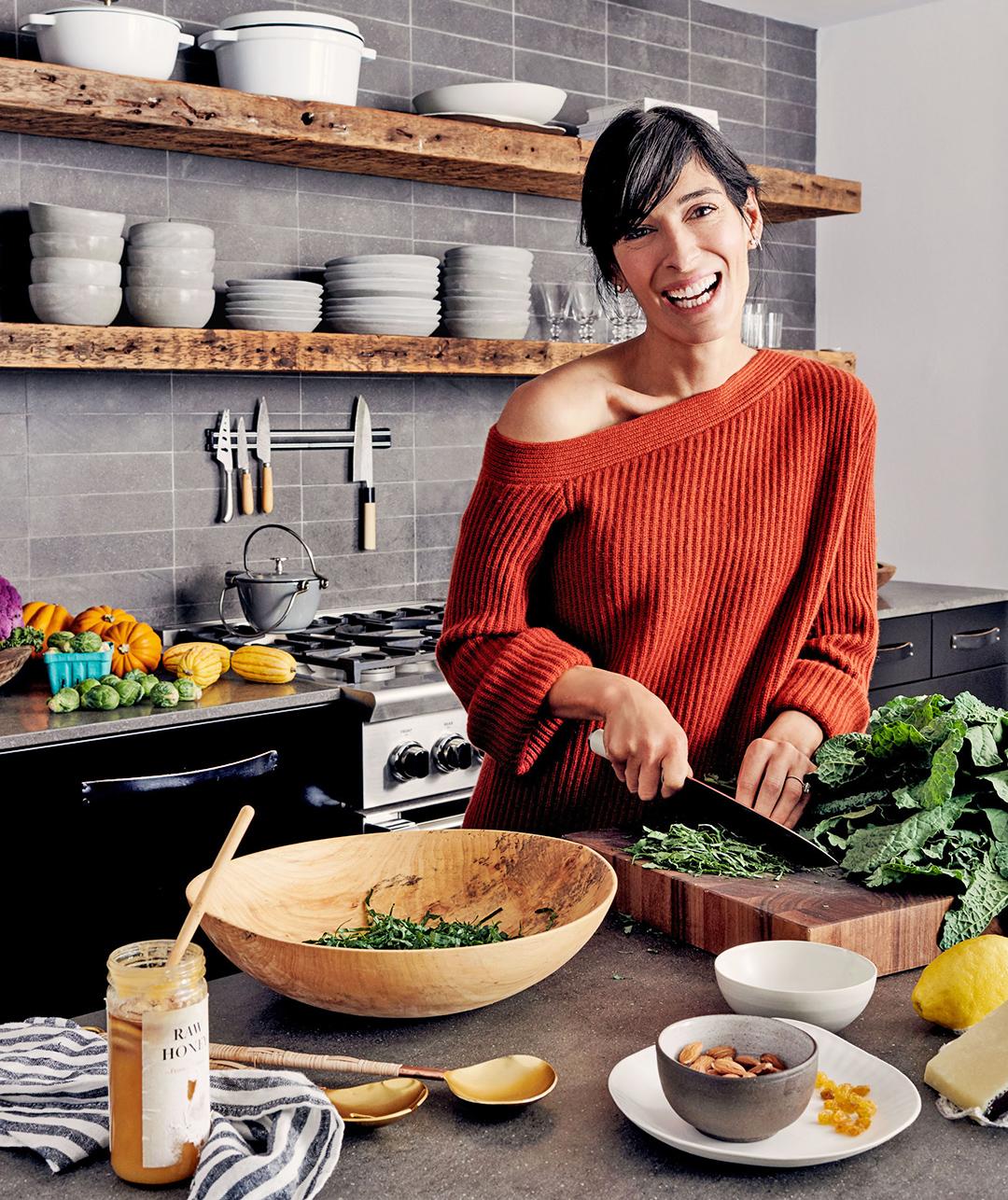athena in kitchen cutting vegetables