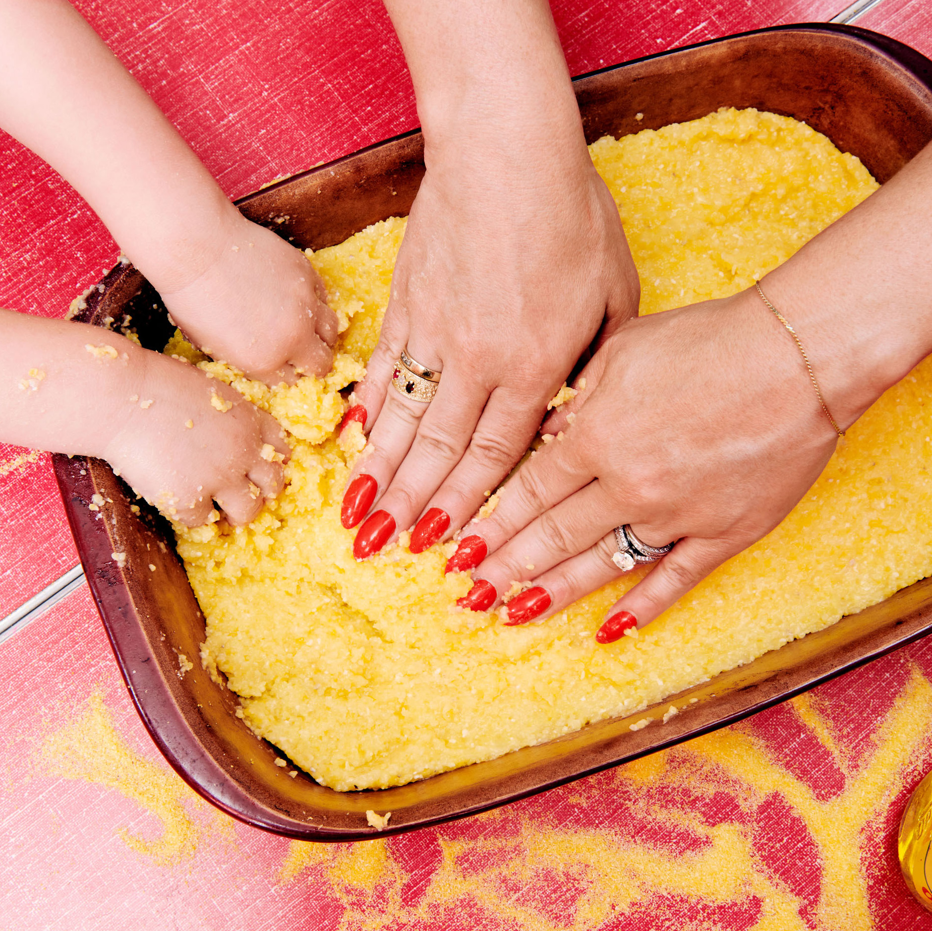 all hand in polenta making