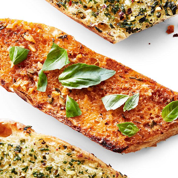 sun-dried tomato garlic bread with fresh basil
