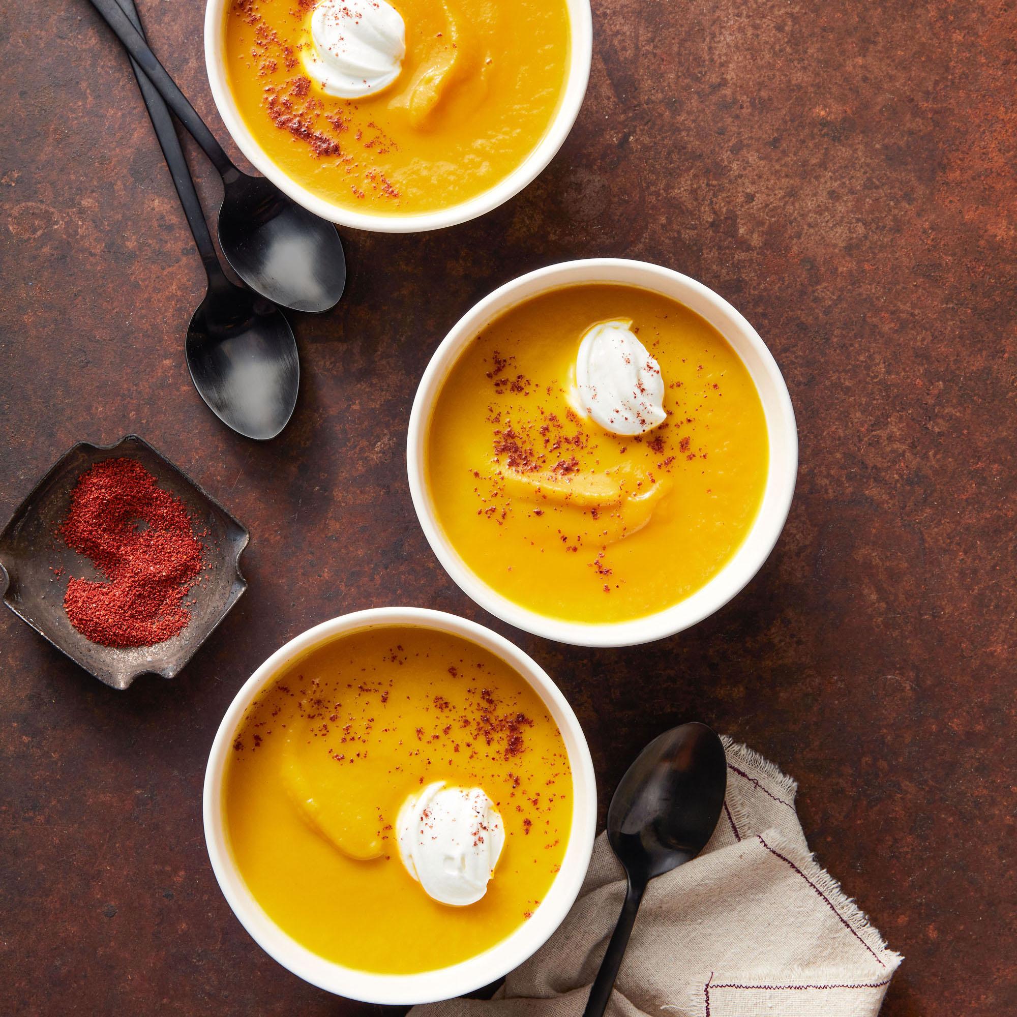 Carrot & Sunchoke Soup in three white bowls