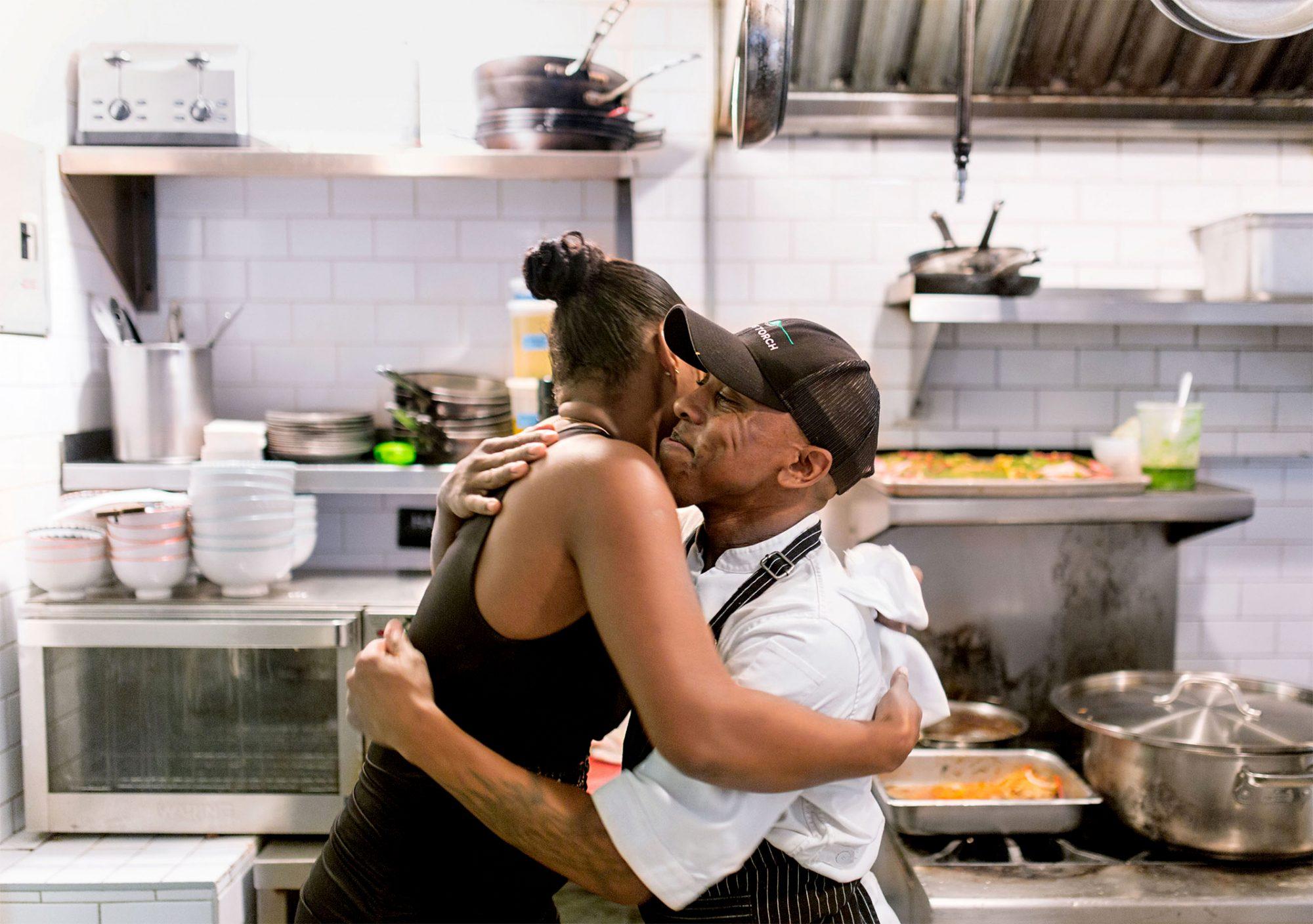 emmas torch graduate and director hugging