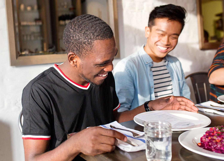 emmas torch graduates laughing at table