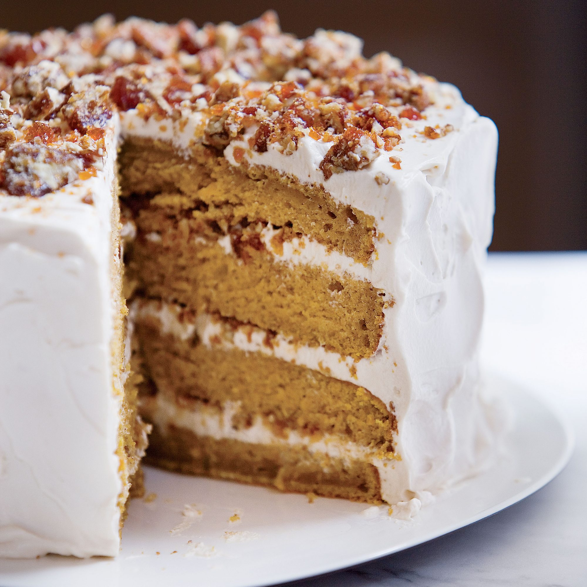 pumpkin cake with whipped cream and pecan praline