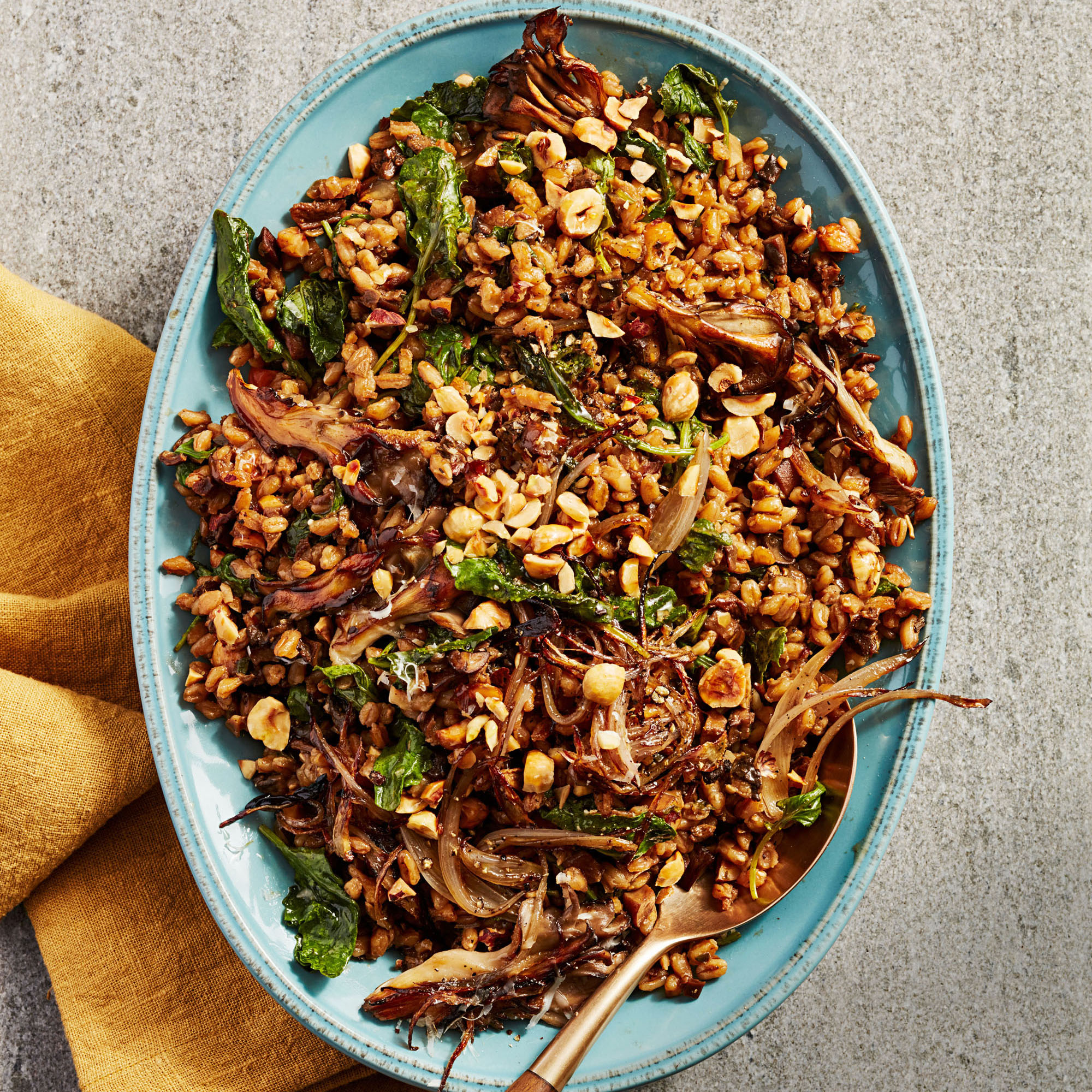 farro with mushrooms and hazelnuts on blue platter