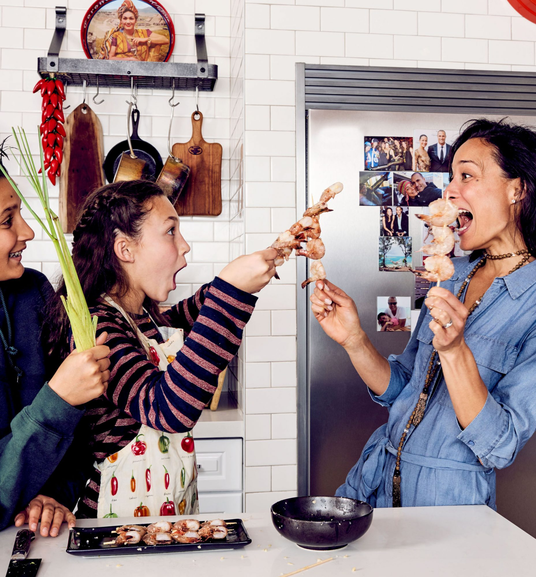 family playing with shrimp skewers