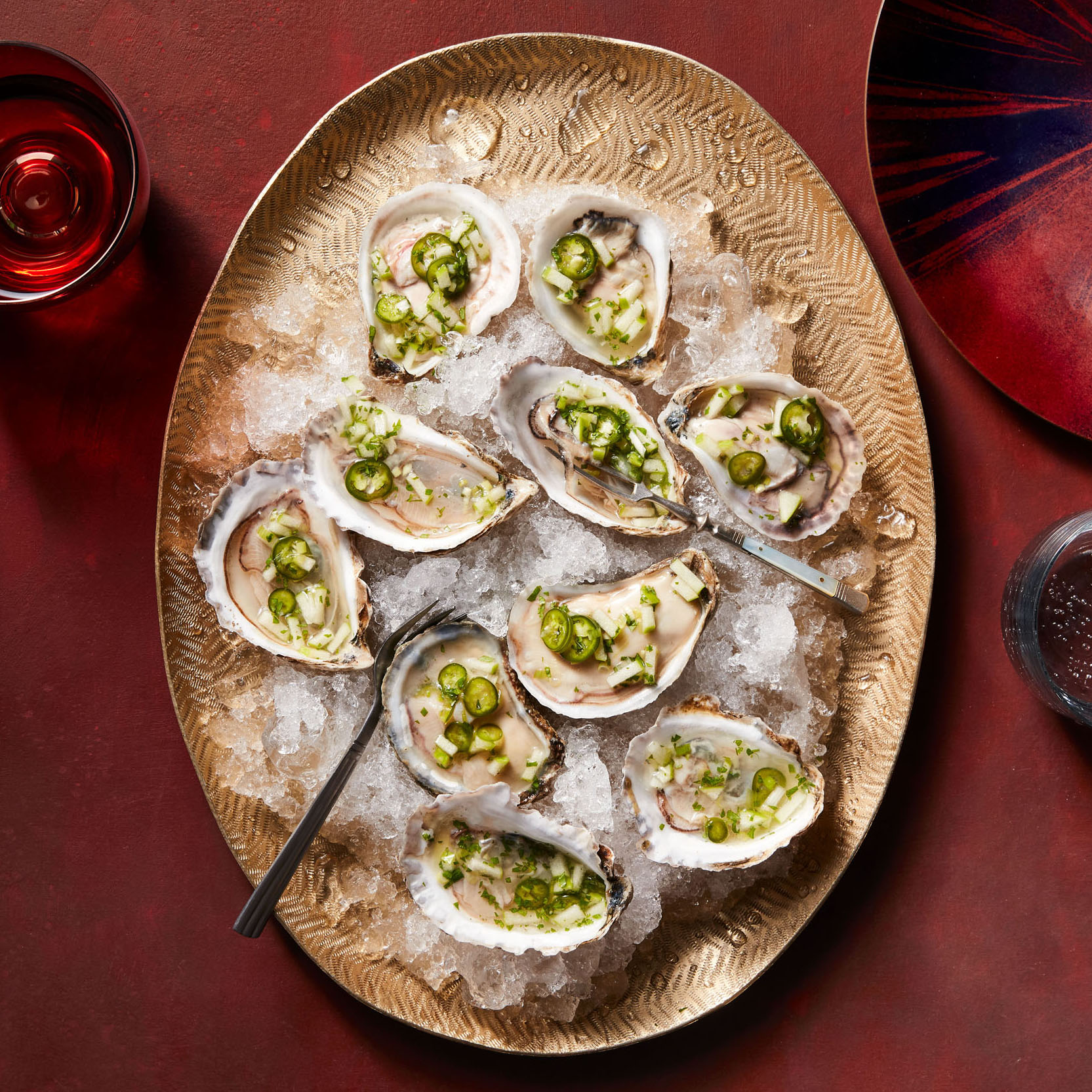 oysters with green apple-jalapeno mignonette served on gold platter