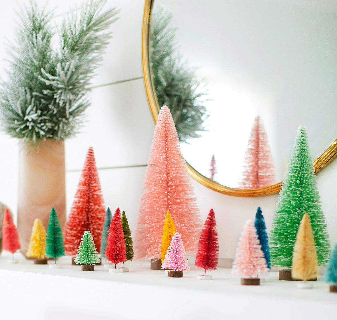 colorful bottlebrush trees on mantel