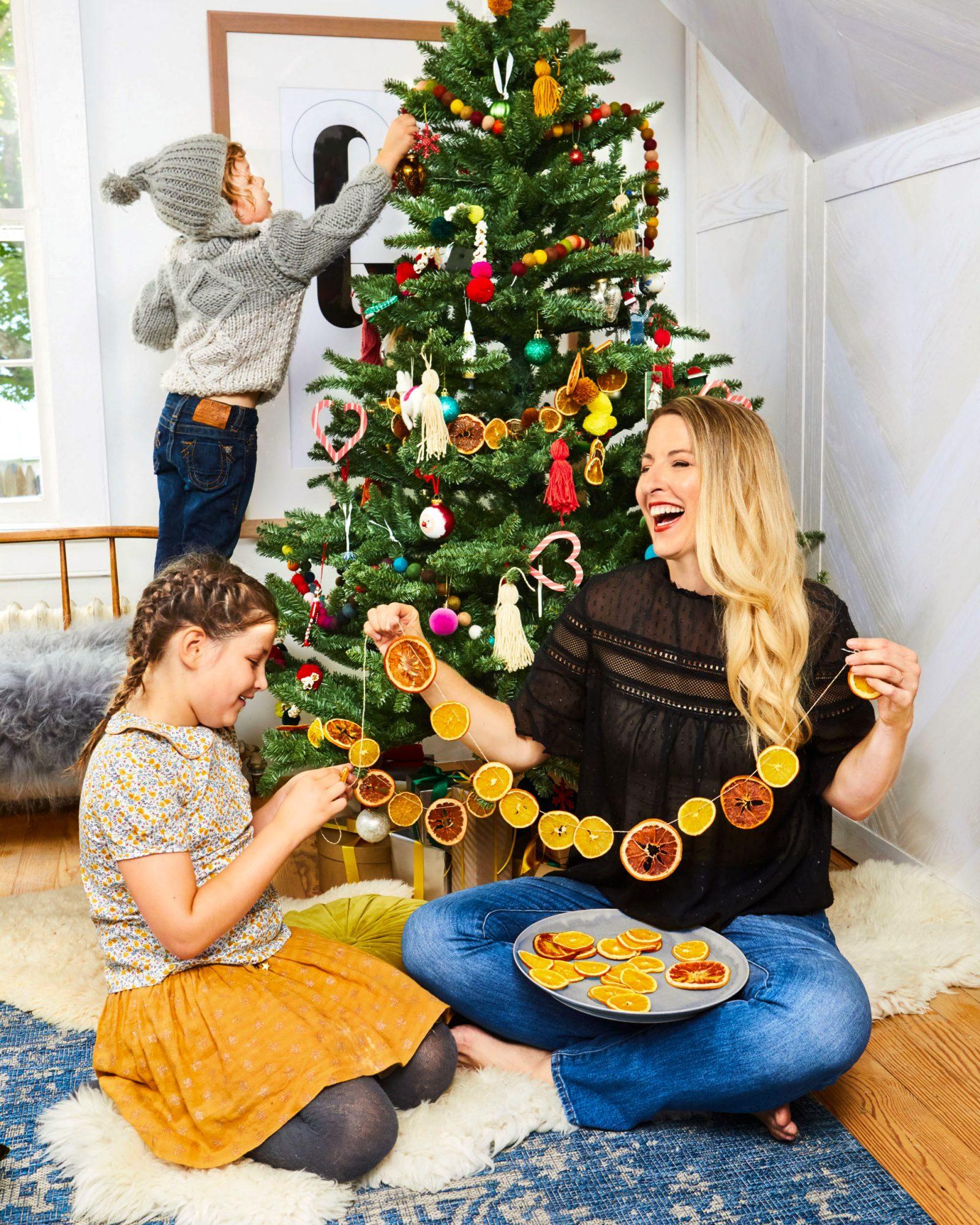 christmas tree decorating orange string family