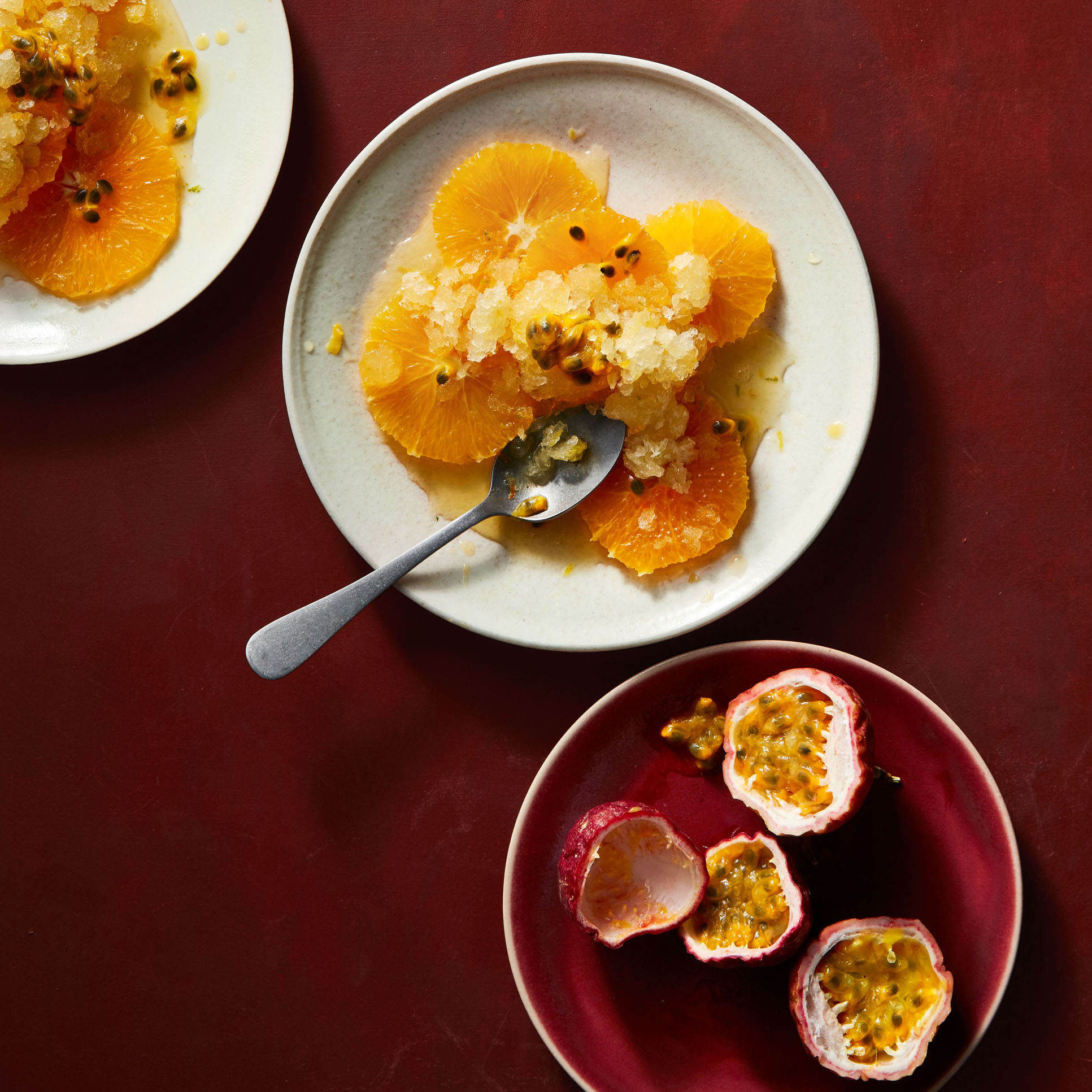 triple-citrus granita with passion fruit topped with oranges