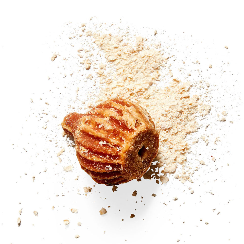 jaggery unrefined sugar against white background