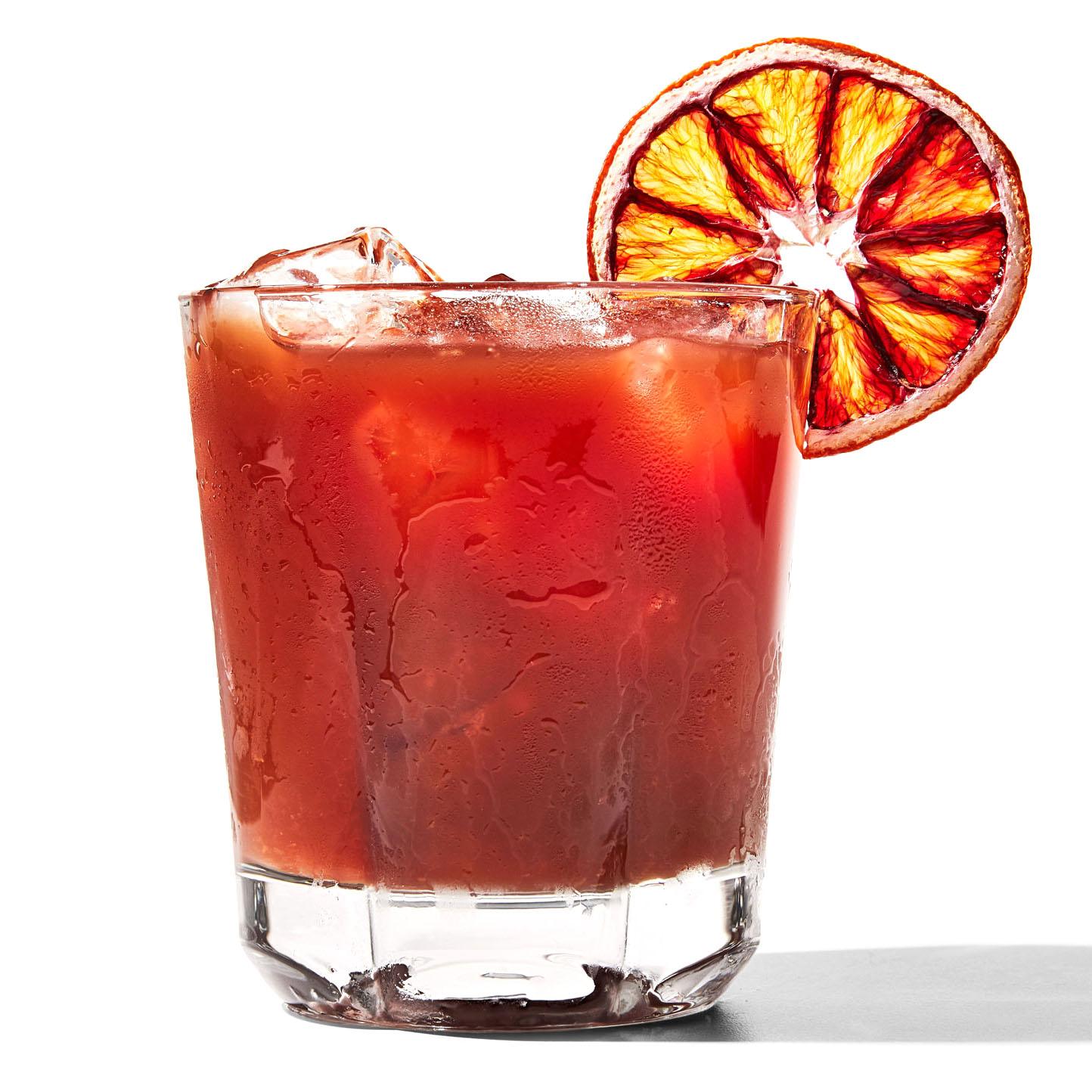 never let me go cocktail garnished with orange slice