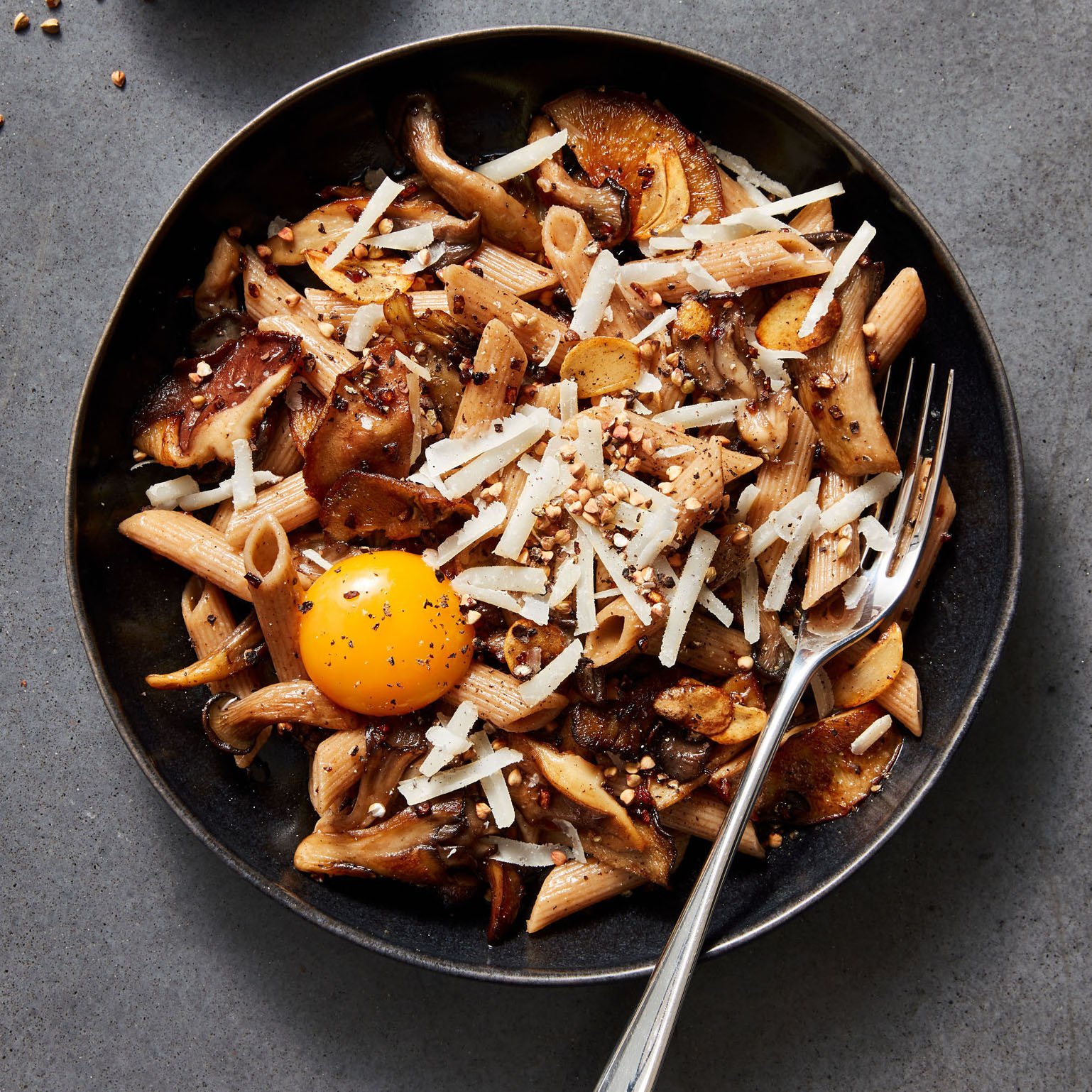 pasta with brown butter mushrooms and topped with an egg