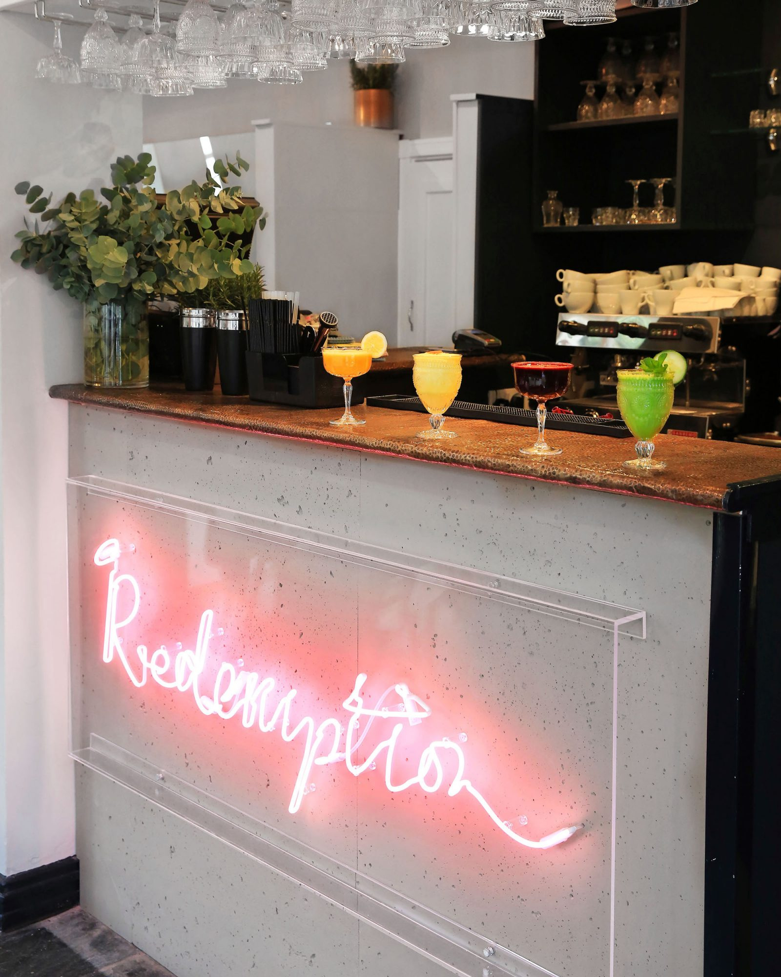 bar with neon redemption sign