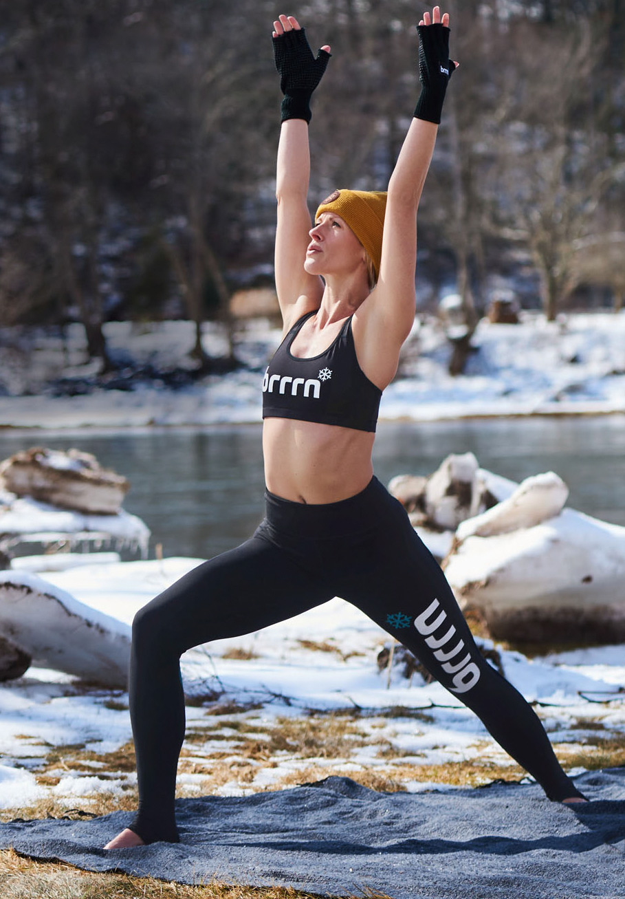 woman doing yoga pose in cold weather outdoors
