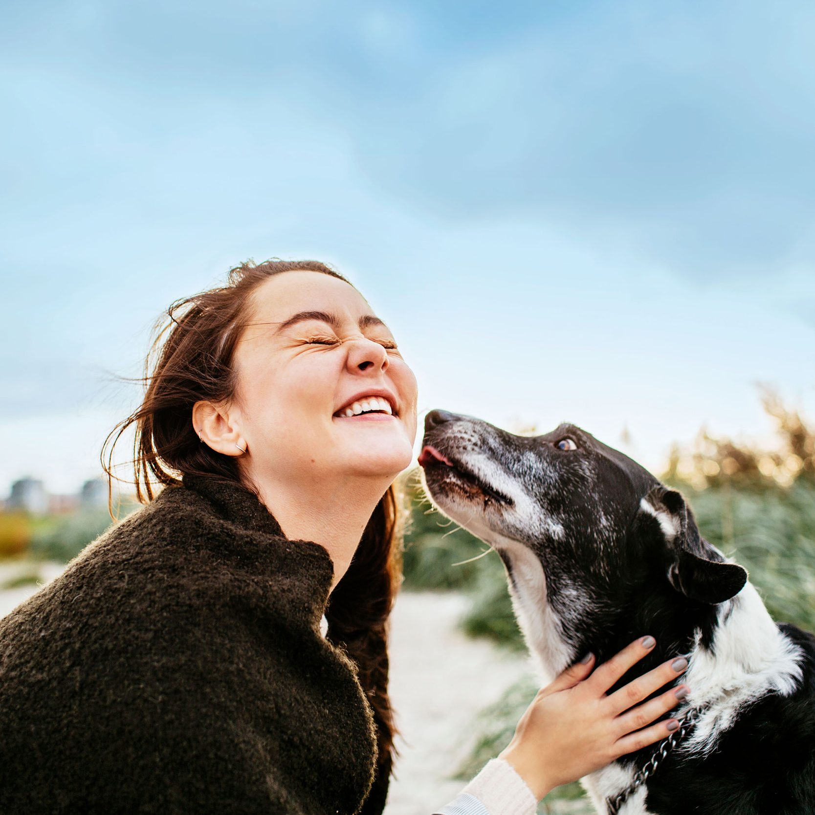 girl smiling with dog square