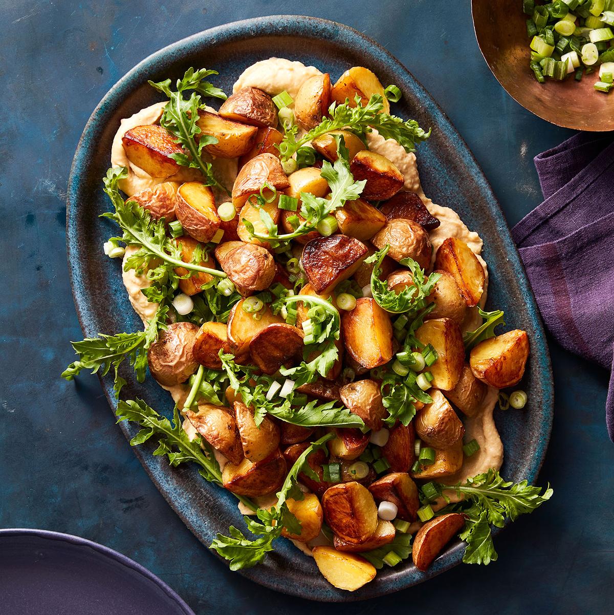warm potato salad with hummus arugula