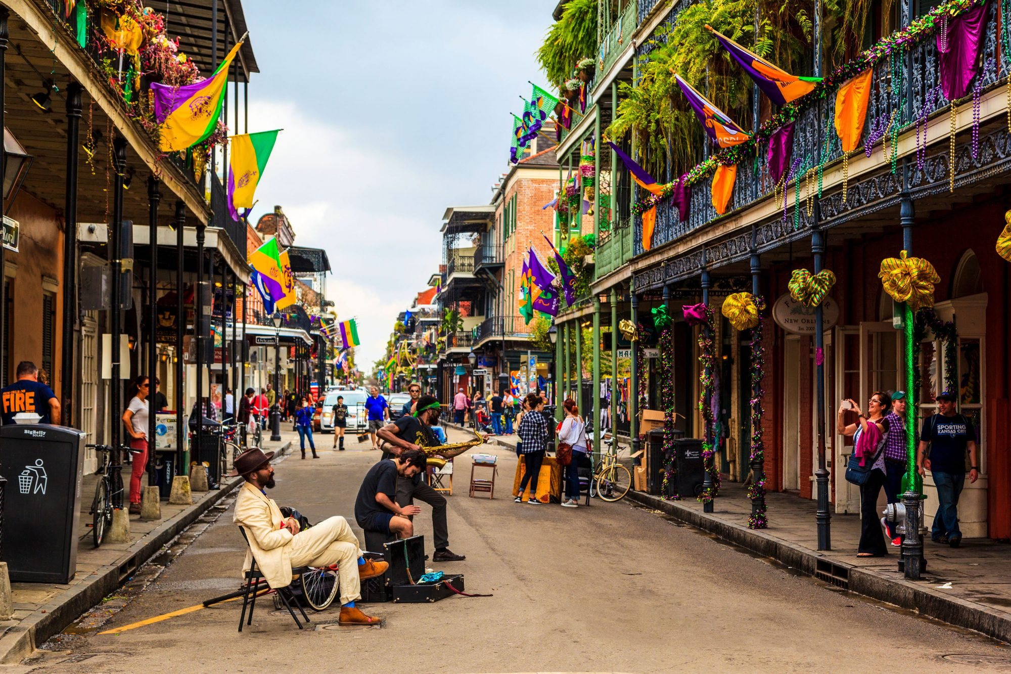 musicians performing in colorful new orleans street