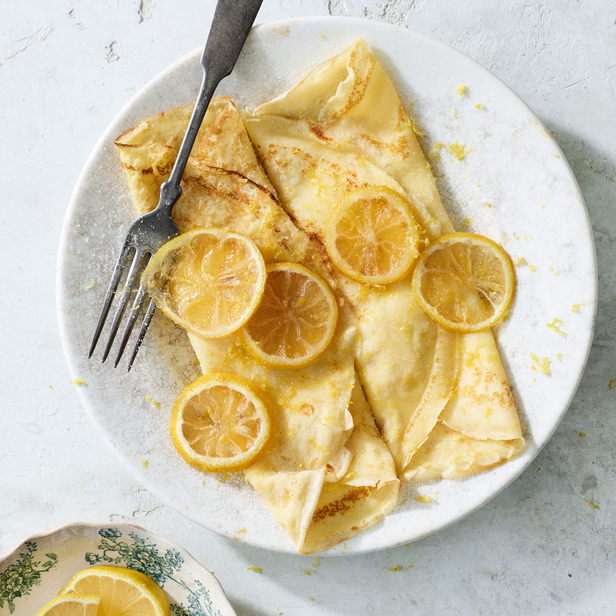rolled pancakes with lemon sugar and candied lemon slices