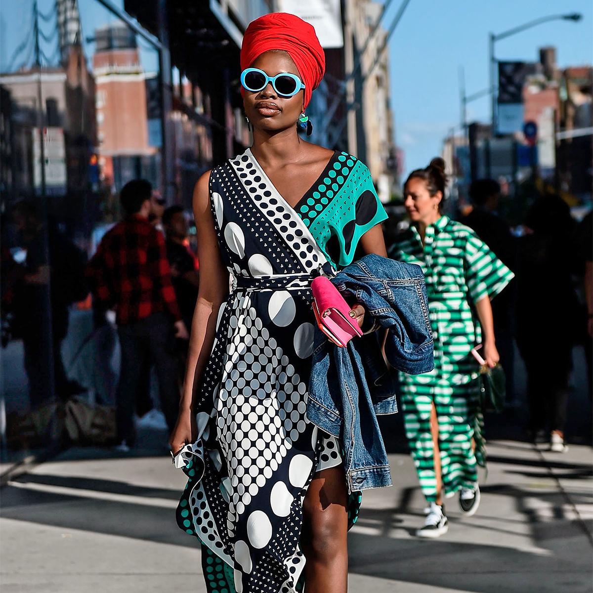 woman wearing asymmetrical patterned dress