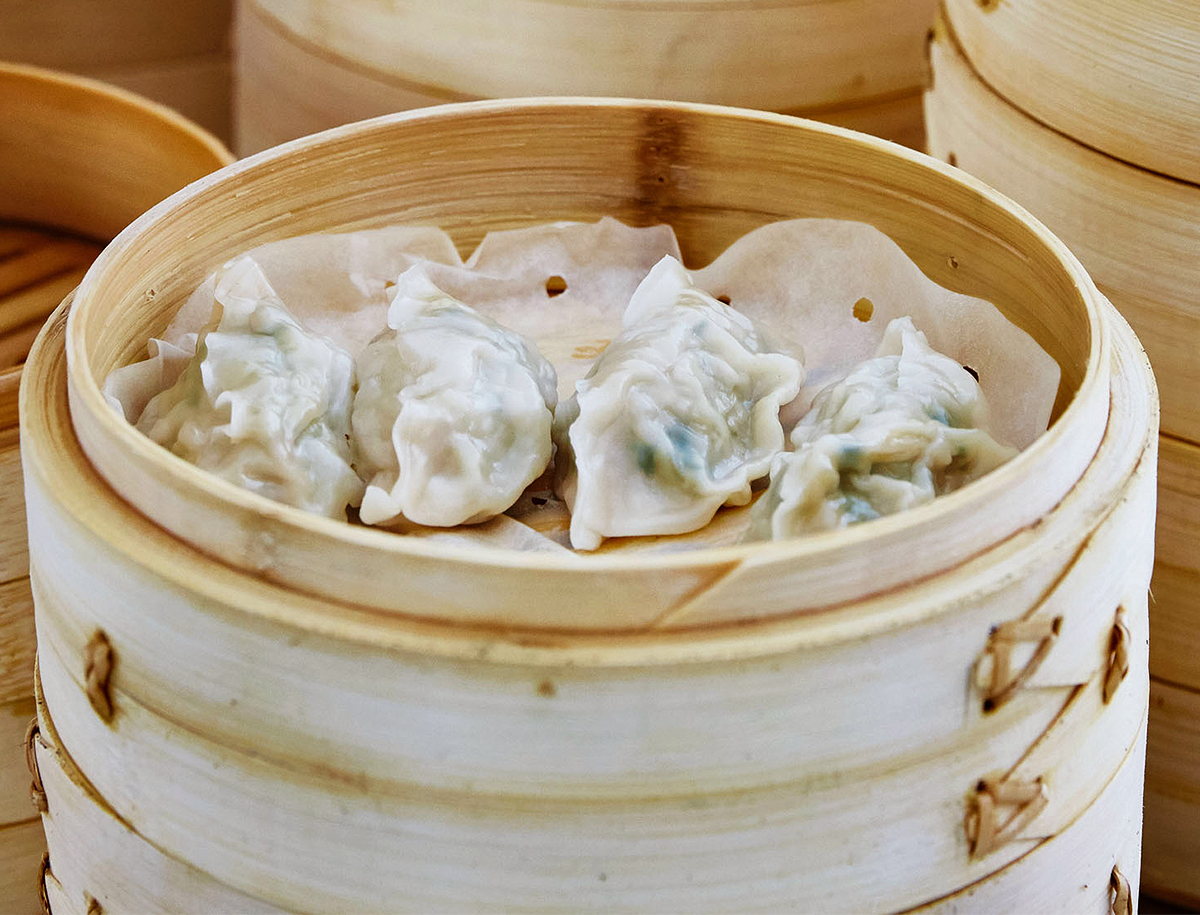 mimi cheng's steamed dumplings on top of barrel
