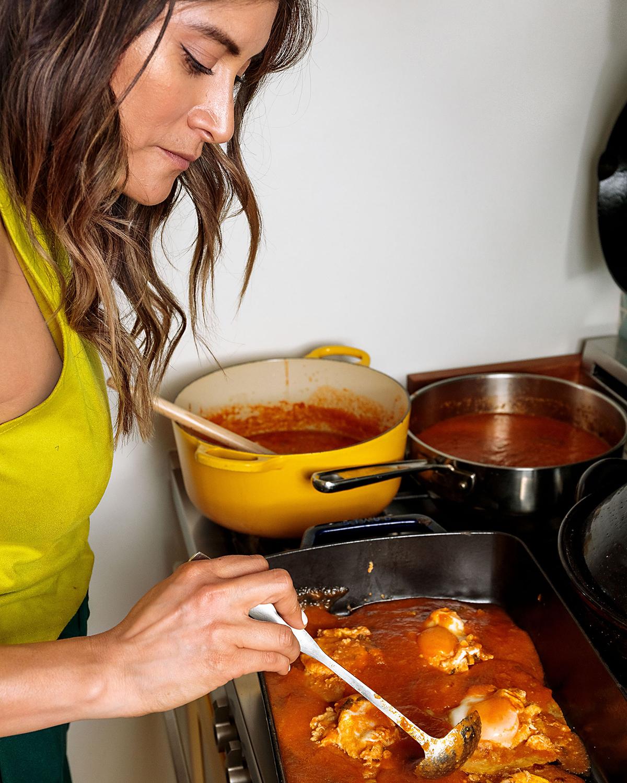Bricia Lopez ladeling sauce