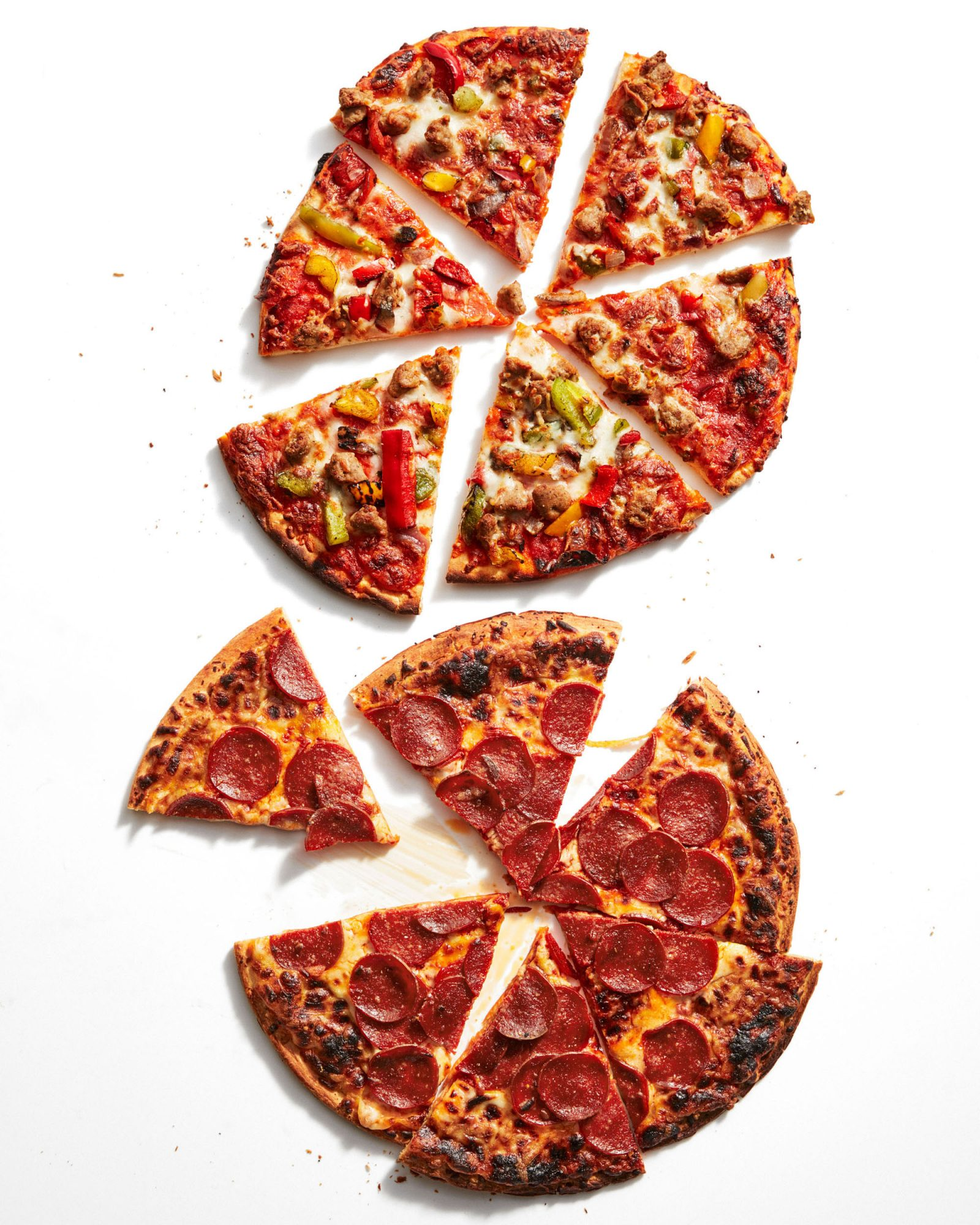 two frozen pizzas sliced