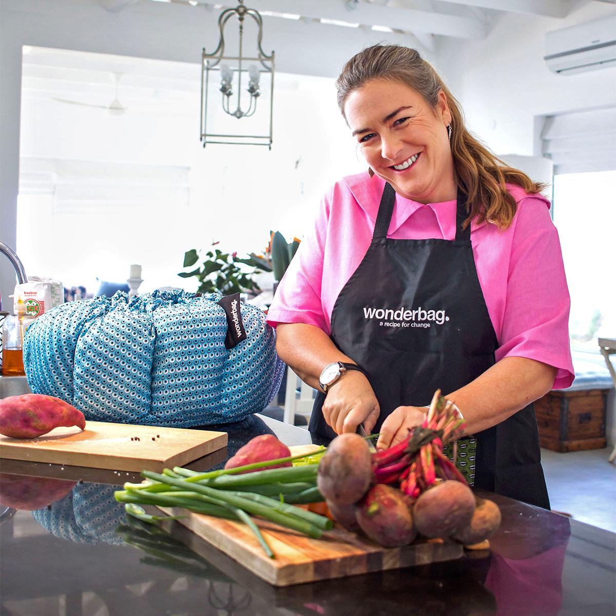 Sarah Collins with wonderbag slicing vegetables