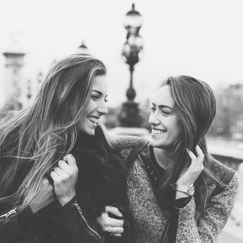 women walking and laughing in paris