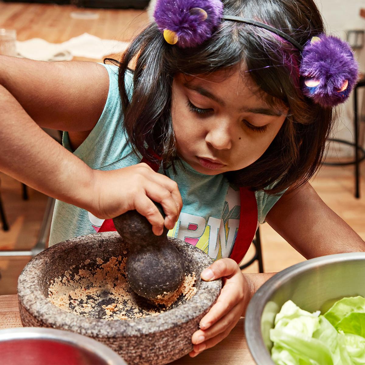 girl using mortar and pestle