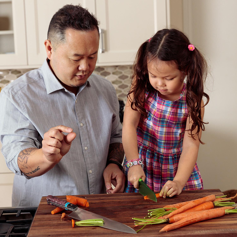 chef Jet Tila and daughter Amaya chopping veggies