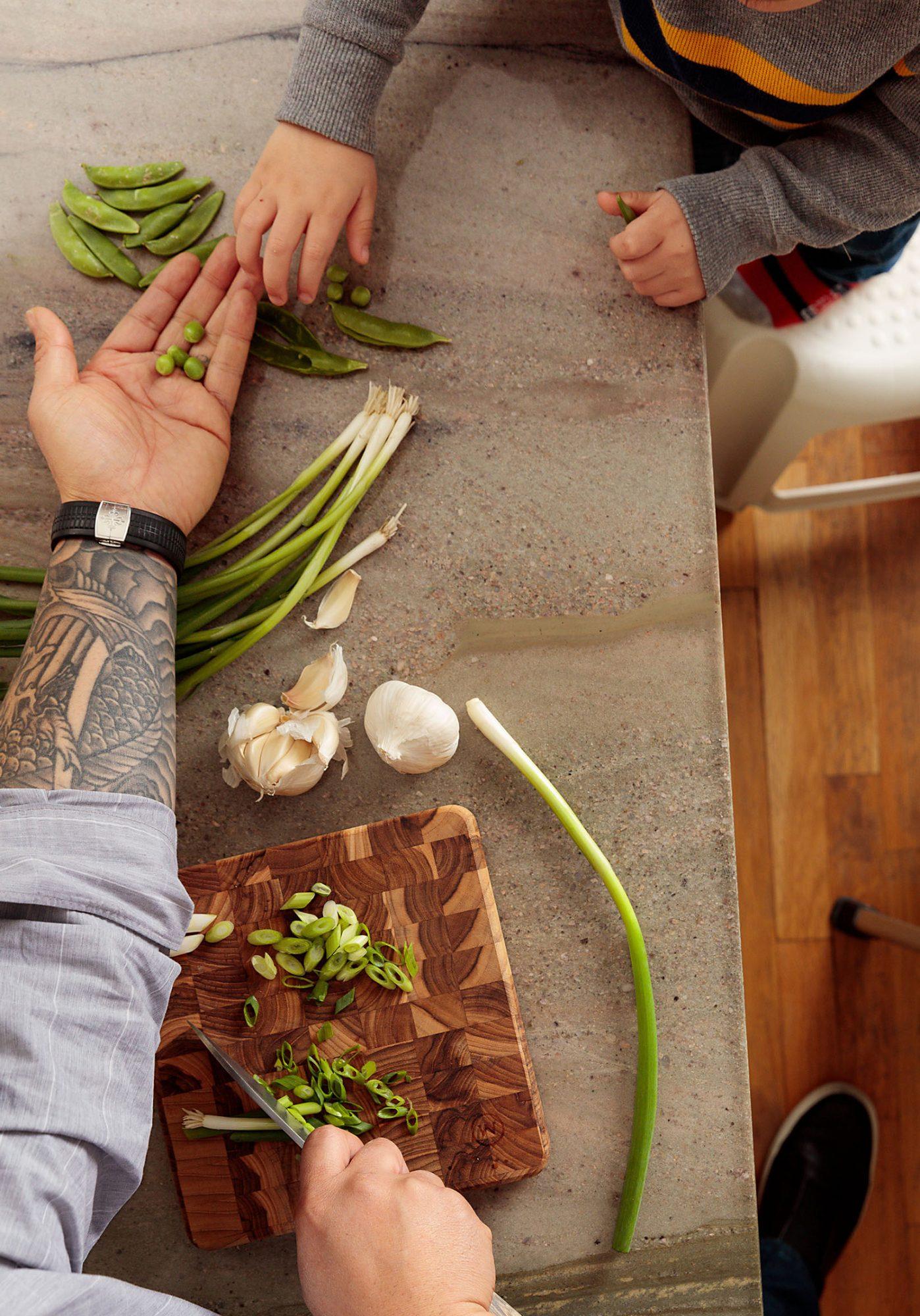 chef Jet Tila chopping veggies with son Ren