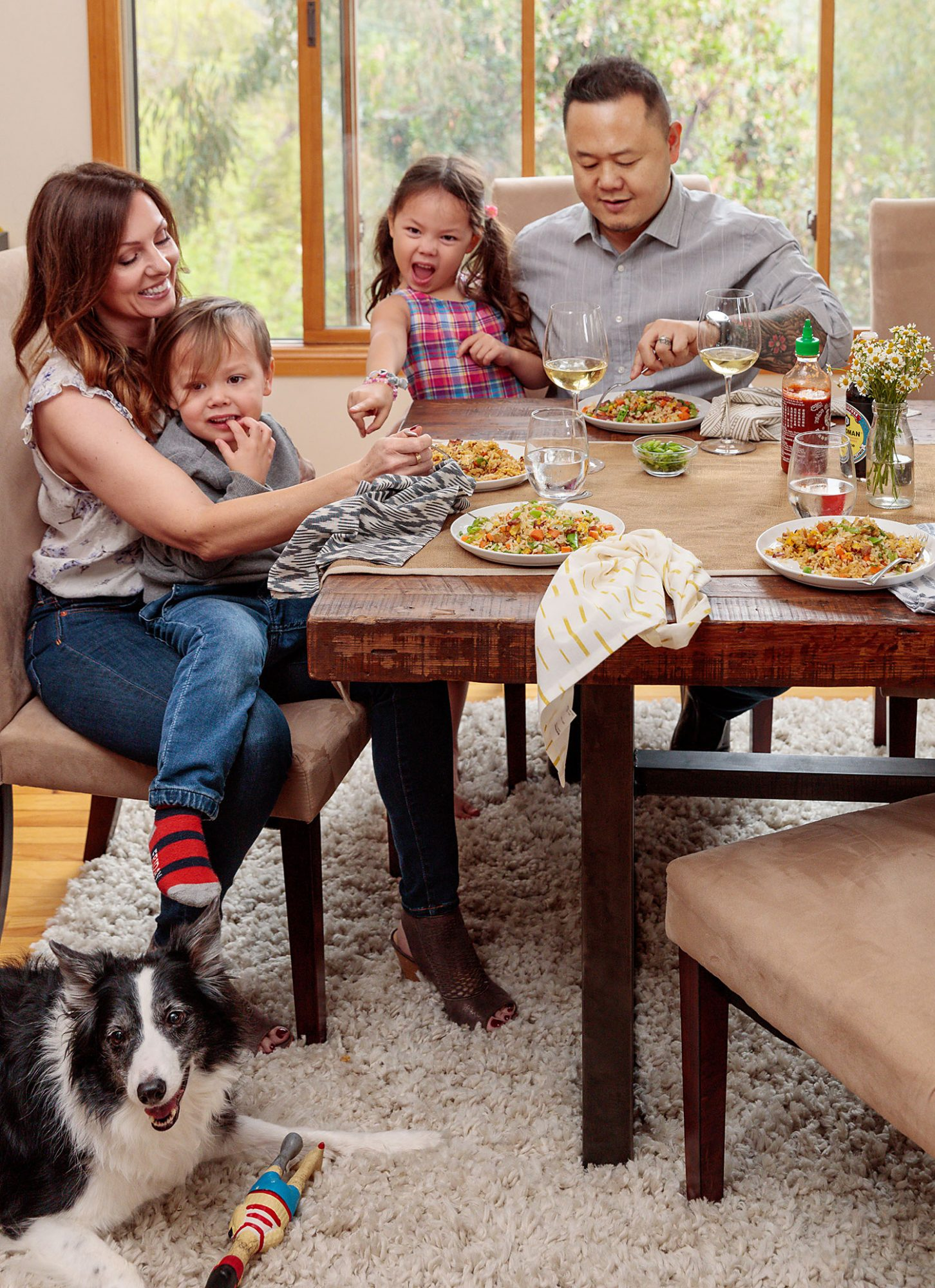 chef Jet Tila and family eating at dining room table
