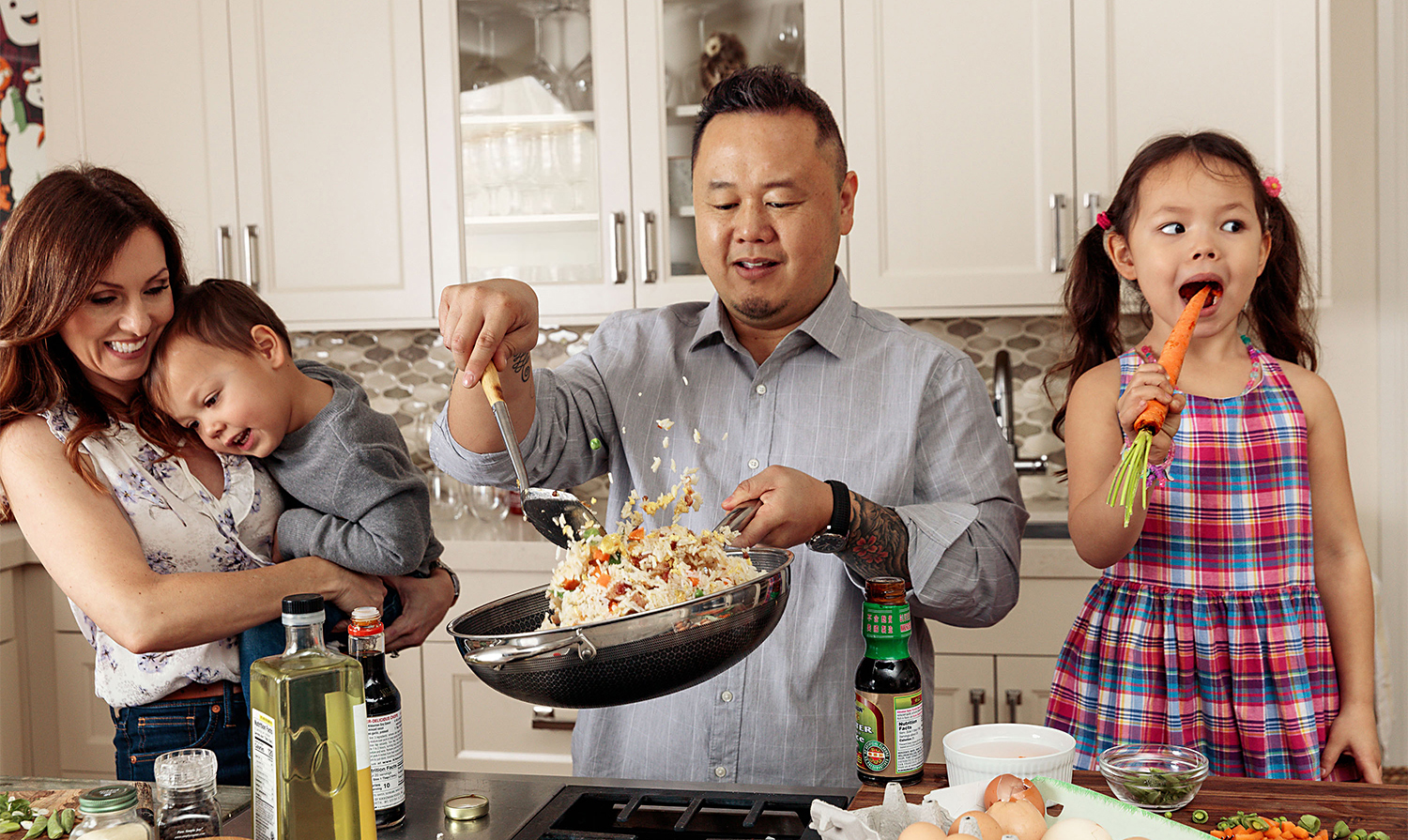 chef Jet Tila cooking with family in kitchen