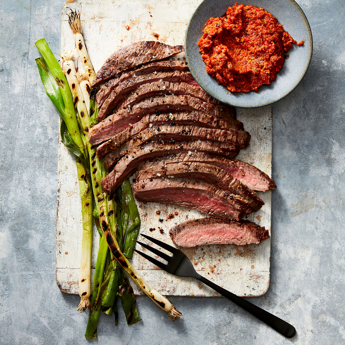 Grilled Steak with Peppadew Romesco & Grilled Scallions