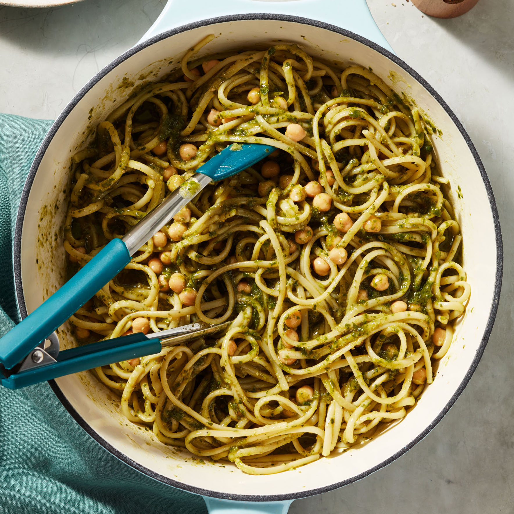 Chickpea and Basil Pasta served with blue tongs