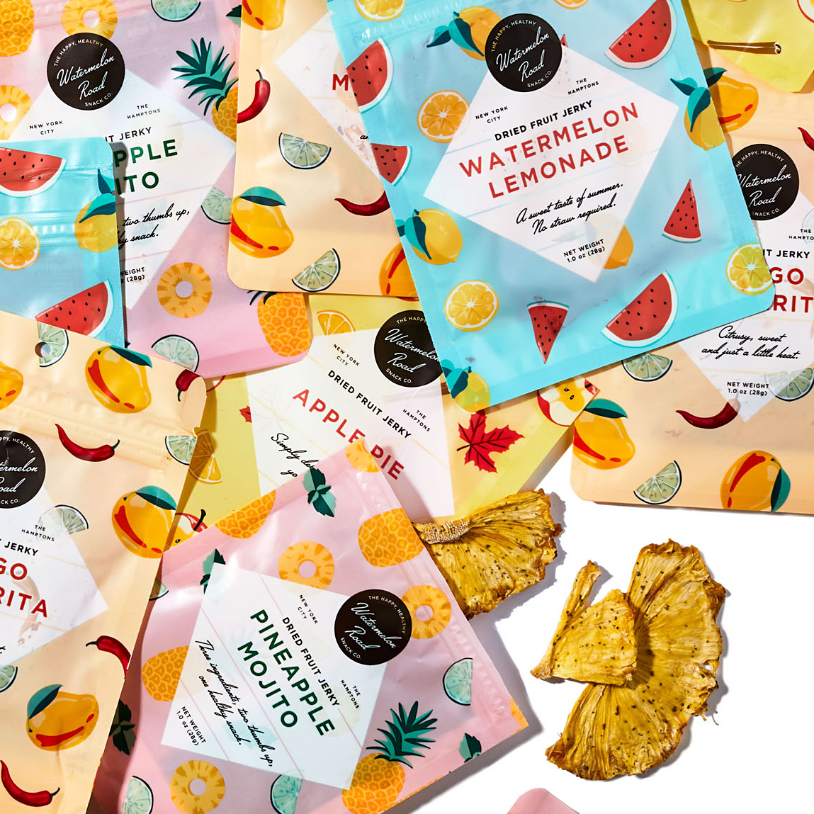 assorted fruit jerky packets and dried pineapple
