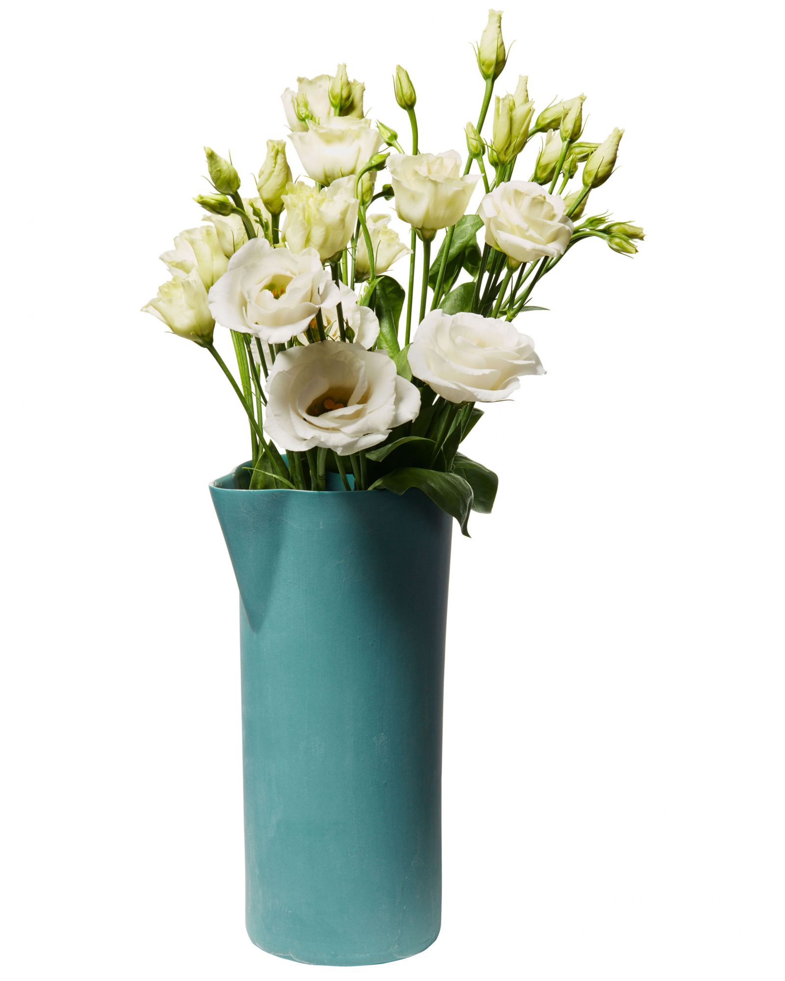 green handmade pitcher containing white roses