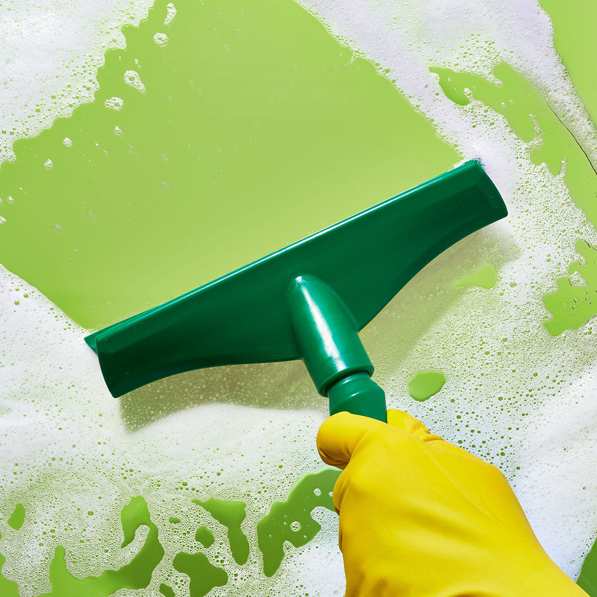 green squeegee and rubber glove